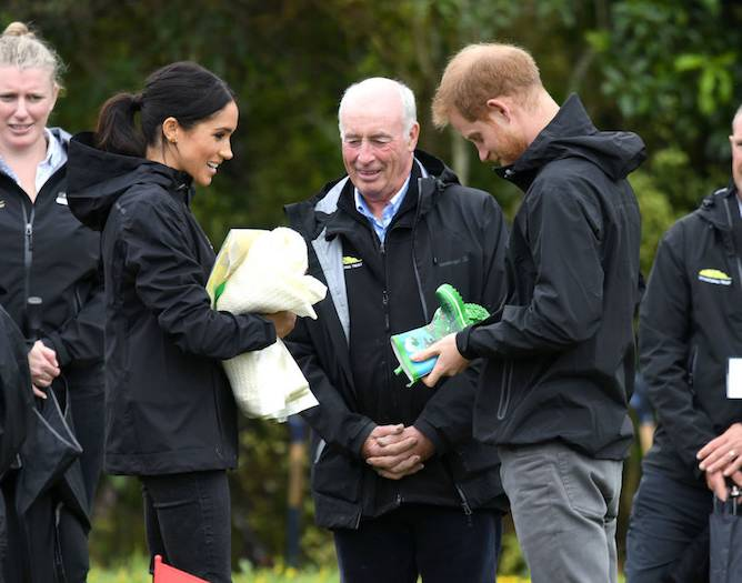 More gifts for the parents to be This time it was a sweet pair of Wellington boots for baby Sussex which was certainly fitting for the days weather forecast Photo C GETTY IMAGES