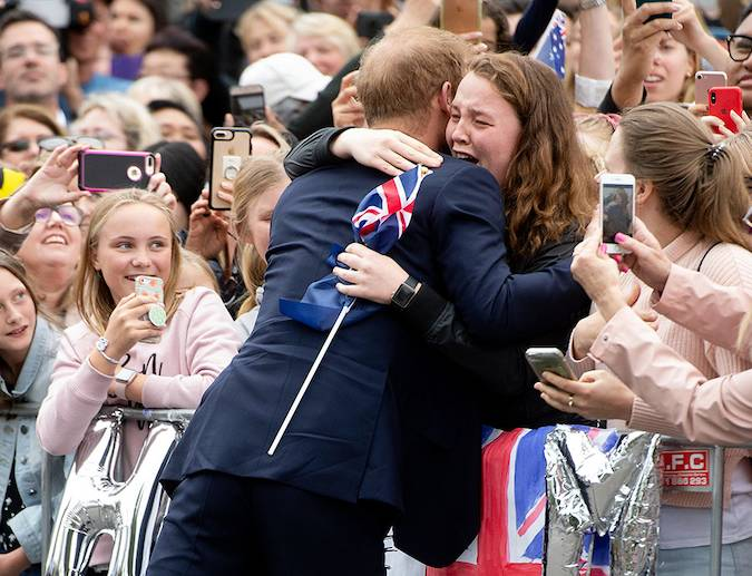 One fan who was overwhelmed to meet Harry was a young girl who reached over the barriers to hug the Prince Photo C GETTY