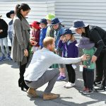 Prince Harry also chatted to young Joe as the royal couple met with children who had lined up outside the cafe