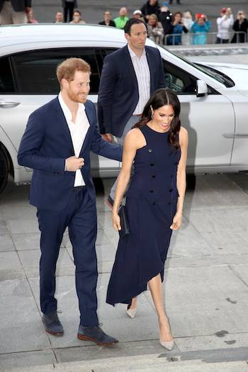 Prince Harry looked equally smart in a matching navy blue suit which he teamed with an open collar white shirt and suede shoes Photo C GETTY