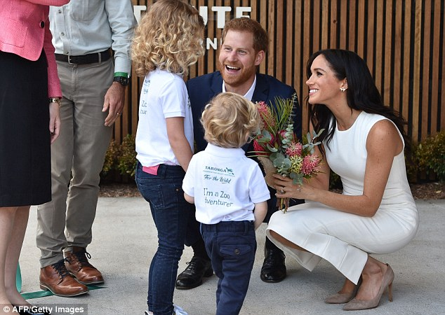 Prince Harry was left in stitches after he was ignored by six year old Dasha Gallagher left who decided to give a bunch of flowers to Meghan Markle instead of the prince