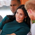 Prince Harry was photographed leaning in to chat to his wife before sharing a giggle Image Getty