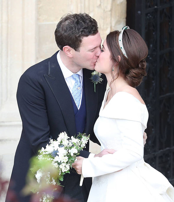 Princess Eugenie and Jack Brooksbank shared a kiss on the steps of St Georges Chapel Image PA