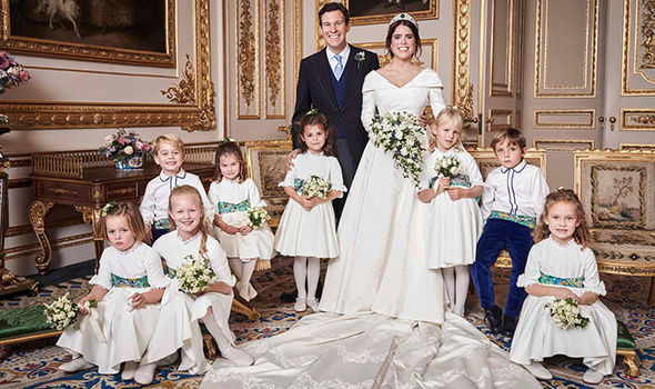 Princess Eugenie and husband Jack Brooksbank pose in with their bridesmaids and pageboys Image AFP Getty Images