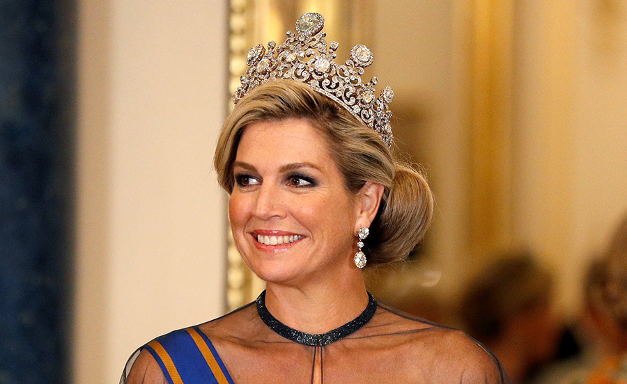 Queen Maxima was dressed to impress in a blue cape dress The Dutch queen who is of Argentinian origin Photo C GETTY