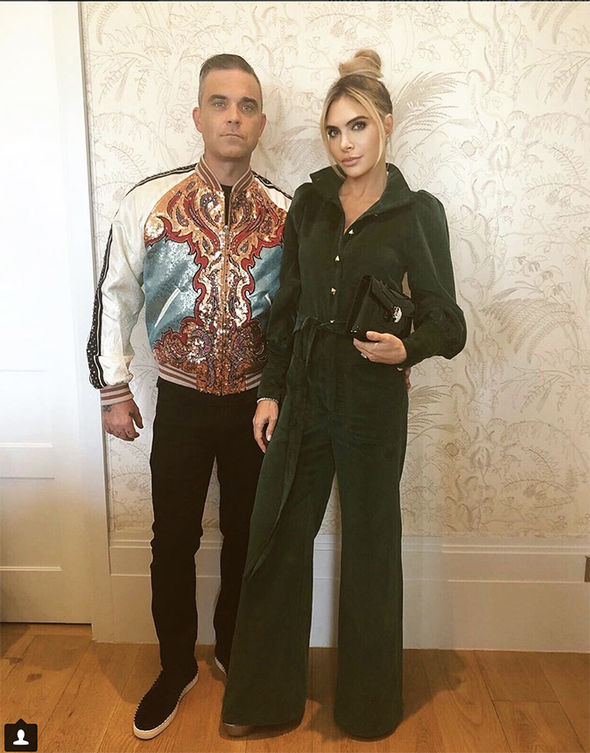Royal wedding Robbie Williams and Ayda Field pose in their gladrags for Eugenies third party Image INSTAGRAM