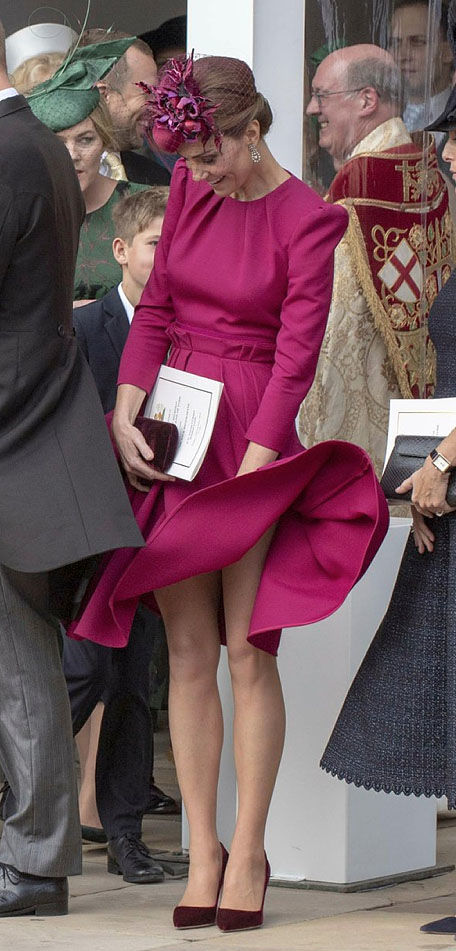 She teamed her flyaway dress with a feathered hat of the same colour Image GETTY