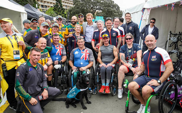 HANDS ON Prince Harry buckles up a cyclist Image twitter