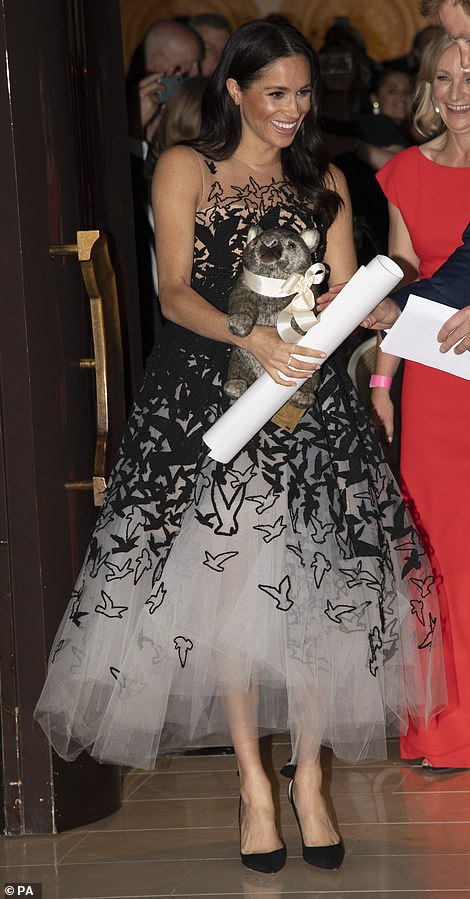 The Duchess holds a scroll and a toy wombat Ironically Prince William was nicknamed wombat by his mother Princess Diana