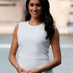 The Duchess of Sussex also wore Dianas gold bracelet on the first day of her royal tour in Sydney above