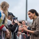 The Duchess of Sussex was also given a homemade red rose brooch by Alexandra MacKay 10 which she pinned on to her Karen Walker trench coat pictured