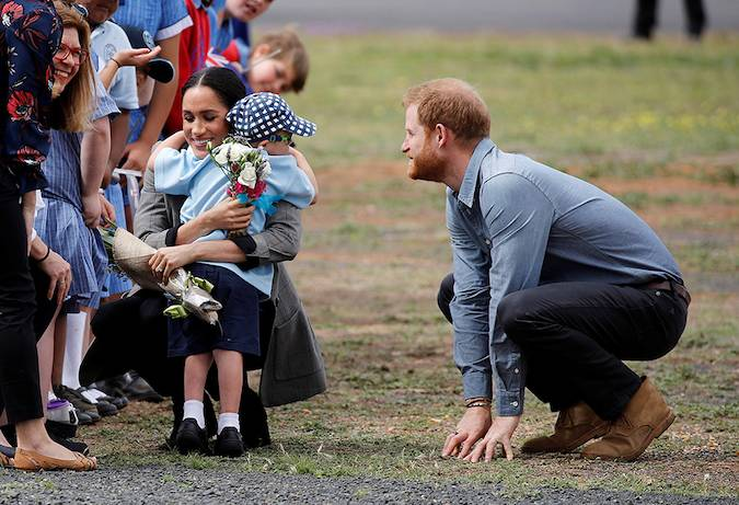 The Duchess showed off her maternal side as she arrived at Dubbo Airport and bent down to hug five year old Luke Vincent Photo C GETTY