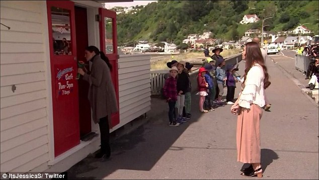 The children who received cakes were just several of the starry eyed schoolchildren who lined the streets outside the cafe hoping to get a glimpse of royalty