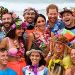The couple fully got into the spirit of anti bad vibes wearing a Hawaiian lei around their necks Image Getty