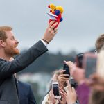 The couple were given a Buzzy Bee a popular toy from New Zealand which Harry held in celebration after it was passed down through the rows of crowds pictured