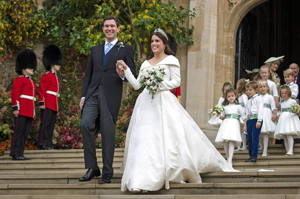 The newlyweds leave St Georges Chapel Image PA