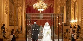 The wedding outfits are on display in one of the opulent rooms of Windsor Castle Meghan and Harry tied the knot at the residences St Georges Chapel on May 19
