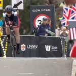 Union Jacks are waved as the cyclists zoom past Image ABC TV