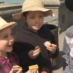 When the cafe agreed the cakes were then brought outside to give to the kids who proudly smiled with their new sweet treats pictured