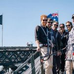 While the Duchess had her feet firmly on the ground Harry climbed Sydney Harbour Bridge alongside Invictus competitors to raise the flag for the Games Photo C GETTY