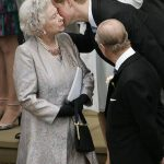 02 The heartwarming times the Queen has received a kiss from members of her family