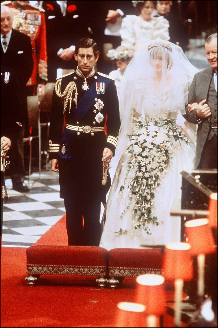 Charles wore his full naval commander uniform for the service while a nervous Diana stumbled her words as she said her vows during the vows Image Getty