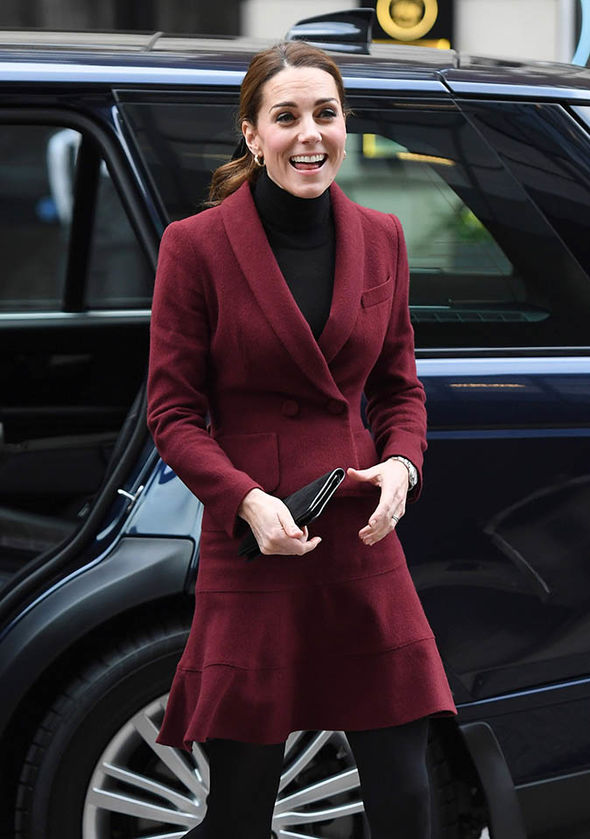 Kate Middleton news The Duchess visits UCL wearing a burgundy outfit with a black clutch Image GETTY