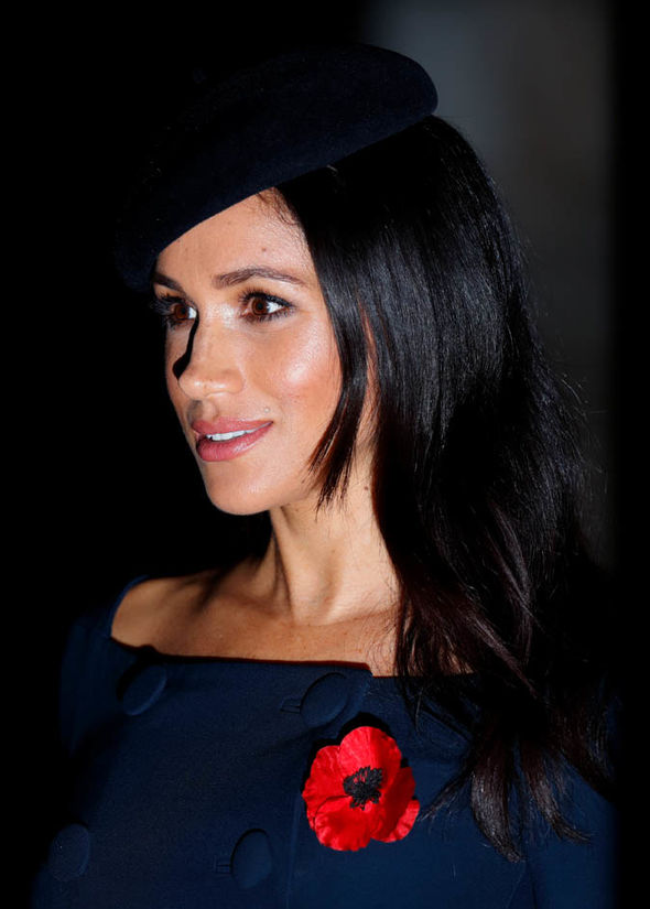 Meghan had noticeably shorter strands of hair around her face Image GETTY