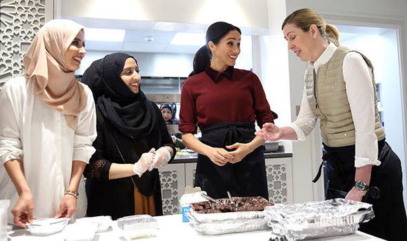 Meghan is pictured chatting with local women at this weeks visit to the Hubb Community Kitchen Image Chris Jackson Getty Images