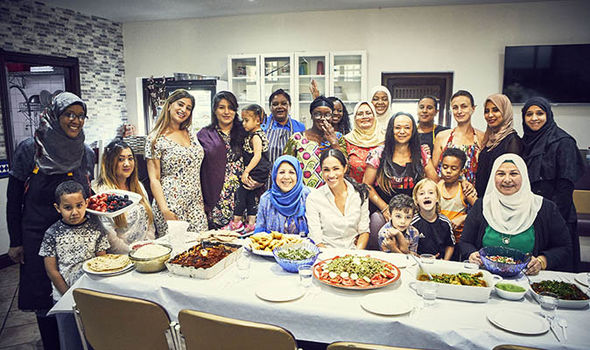 Meghan with women in the Hubb Community Kitchen at the Al Manaar Muslim Cultural Heritage Centre Image Jenny Zarins via Getty Images
