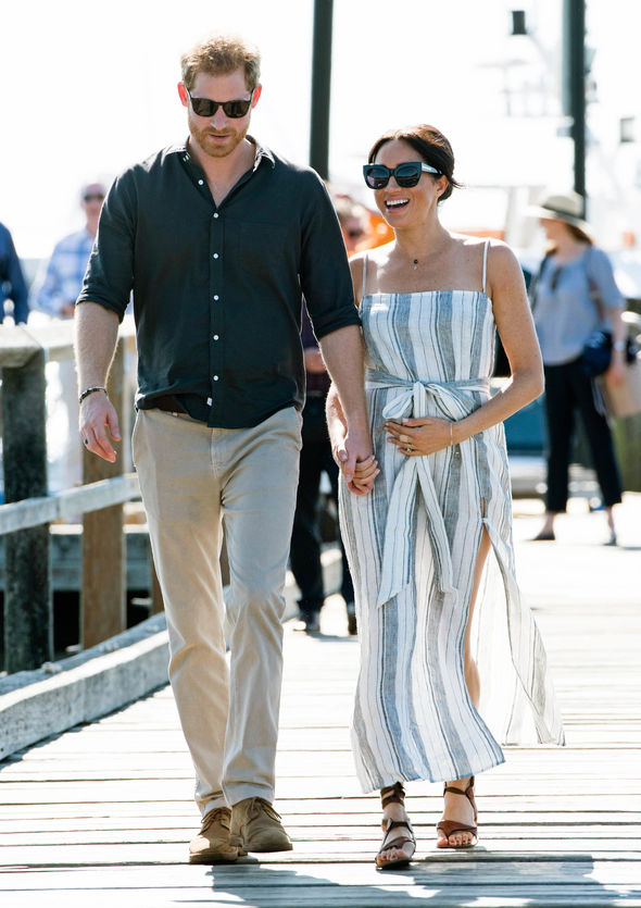 Meghan wore a semi sheer dress during a walkabout in Fraser Island Image GETTY
