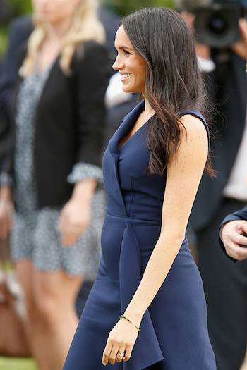 MID NOVMBER The Duchess protruding bump really started to show in October November time Here Meghan is pictured Photo C GETTY IMAGES