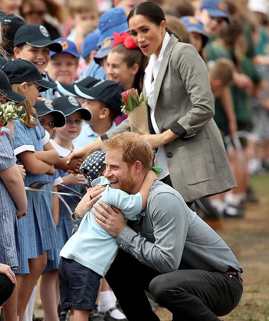 Prince Harry loved this cuddle with little Luke when he visited Dubbo with Duchess Meghan as part of the recent Royal Tour Down Under Image Getty Images