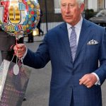 Prince talks to reporters after being given a gift and balloon Image Tim Rooke REX Shutterstock
