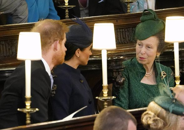 Princess Anne looks at Meghans stomach in the moment before Princess Eugenies wedding ceremony Image AFP