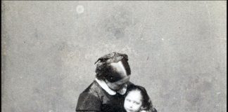 Queen Victoria holding daughter Princess Beatrice Image BNPS