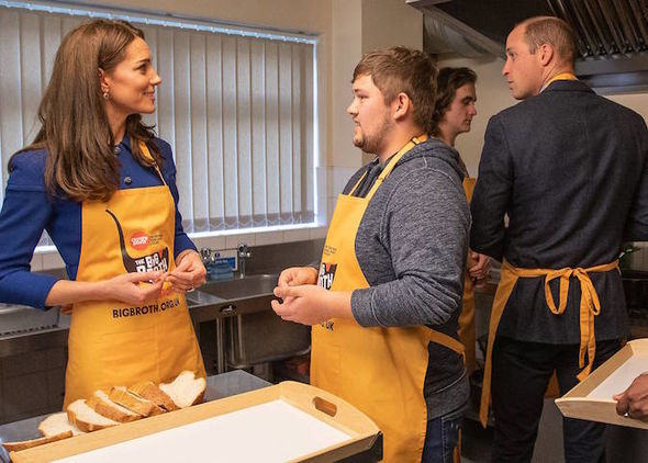 Royal news Kate and William sit down to eat soup and bread that they helped to serve in the kitchen Image GETTY