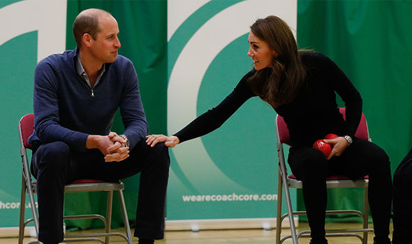 The Duchess of Cambridge reaches out to touch her husbands leg Image GETTY