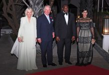 The Prince of Wales and Duchess of Cornwall with President Adama Barrow and his wife arrive at the state dinner PA