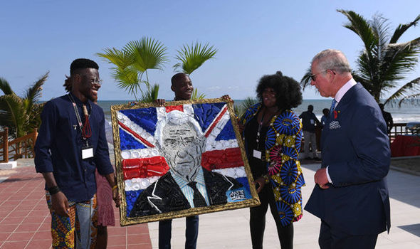 The Prince of Wales is presented with a portrait of himself made from recycled plastics Image Joe Giddens PA