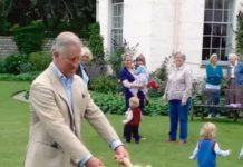 The Prince playing with little Lola Parker Bowles granddaughter of Camilla Duchess of Cornwall Image BBC Clarence House