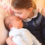 The second portrait showed the newborn and Princess Charlotte who turned three when this photo was taken Photo C GETTY