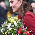 1 Kate chatted to fans as they waited outside the Norfolk church collecting bunches of flowers from wellwishers