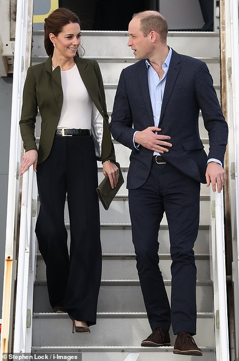 1 Prince William and Kate smile as they arrive for their official visit to RAF Akrotiri in Cyprus this afternoon