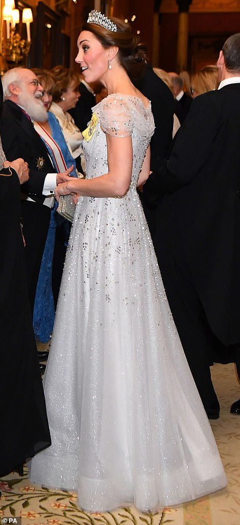 1 The Duchess embellished dress glimmered beneath the soft lights of the Buckingham Palace room where guests mingled