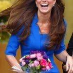 A laughing Kate and her gorgeous shiny mane of hair took centre stage as she left Northolt High School in Ealing Photo C GETTY