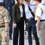A line of military dignitaries were waiting to greet the duke and duchess when they arrived at the base on the RAF Voyager jet