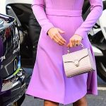 Embracing the handbag The Duchess rarely strays from her beloved clutch bags but for a visit to a Mental Health Summit in London last month she made an exception with this accessory