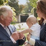 In another heartwarming image Louis is pictured alongside his mum and grandpa in the gardens of Clarence House