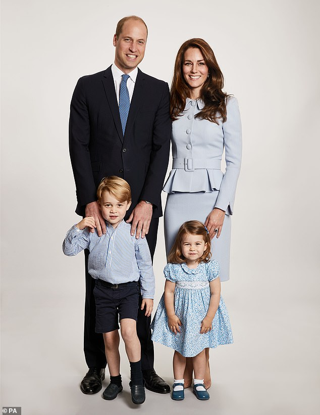 Prince George wore long trousers for the first time ever in an official family portrait in this family snap taken in the Autumn at the Duke and Duchess of Cambridge
